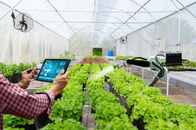 automatic-agricultural-technology-robot-arm-watering-plants-tree_33807-565